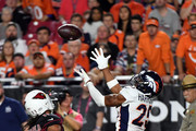 Cornerback Chris Harris #25 of the Denver Broncos breaks up a pass intended for wide receiver Larry Fitzgerald #11 of the Arizona Cardinals during the third quarter at State Farm Stadium on October 18, 2018 in Glendale, Arizona.