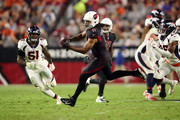 Wide receiver Larry Fitzgerald #11 of the Arizona Cardinals makes a catch over linebacker Todd Davis #51 of the Denver Broncos during the third quarter at State Farm Stadium on October 18, 2018 in Glendale, Arizona.