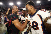 Wide receiver Demaryius Thomas #88 and linebacker Von Miller #58 of the Denver Broncos shake hands with wide receiver Larry Fitzgerald #11 of the Arizona Cardinals after the Broncos beat the Cardinals 45-10 at State Farm Stadium on October 18, 2018 in Glendale, Arizona.