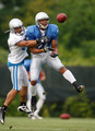 Demir Boldin #14 of the Detroit Lions tries to catch a pass in front of Chris Roberson #33 during training camp at the Detroit Lions Headquarters and Training Facility on August 4, 2009 in Allen Park, Michigan.