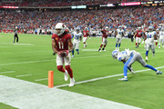 Larry Fitzgerald #11 of the Arizona Cardinals catches a touchdown pass during the fourth quarter of a game against the Detroit Lions at State Farm Stadium on September 08, 2019 in Glendale, Arizona. The game ended in a 27-27 tie.
