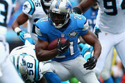 Reggie Bush #21 of the Detroit Lions runs the ball against the Carolina Panthers in the 3rd quarter during their game at Bank of America Stadium on September 14, 2014 in Charlotte, North Carolina.