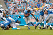 Reggie Bush #21 of the Detroit Lions runs against the Carolina Panthers during their game at Bank of America Stadium on September 14, 2014 in Charlotte, North Carolina.