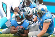 Colin Cole #91 of the Carolina Panthers tackles Reggie Bush #21 of the Detroit Lions during their game at Bank of America Stadium on September 14, 2014 in Charlotte, North Carolina.