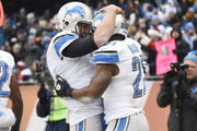 Reggie Bush #21 of the Detroit Lions celebrates bios touchdown with Matthew Stafford #9 during the first quarter of their game against the Chicago Bears at Soldier Field on December 21, 2014 in Chicago, Illinois.