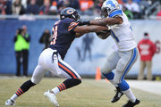 Reggie Bush #21 of the Detroit Lions is tackled by Ryan Mundy #21 of the Chicago Bears during the first half on December 21, 2014 at Soldier Field in Chicago, Illinois. The Lions defeated the Bears 20-14.