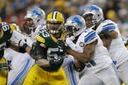 Running back Reggie Bush #21 of the Detroit Lions carries the football in the second half of the NFL game against the Green Bay Packers at Lambeau Field on December 28, 2014 in Green Bay, Wisconsin.