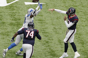 Devin Taylor #98 of the Detroit Lions tips a pass by Brock Osweiler #17 of the Houston Texans in the first quarter during the game between the Houston Texans and the Detroit Lions at NRG Stadium on October 30, 2016 in Houston, Texas.