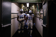 Joique Bell #35 and Reggie Bush #21 of the Detroit Lions walk down the tunnel for their game against the Oakland Raiders during their preseason game at O.co Coliseum on August 15, 2014 in Oakland, California.