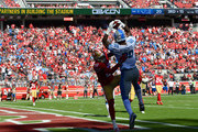 Michael Roberts #80 of the Detroit Lions catches a touchdown pass over Adrian Colbert #27 of the San Francisco 49ers during the fourth quarter of an NFL football game at Levi's Stadium on September 16, 2018 in Santa Clara, California.