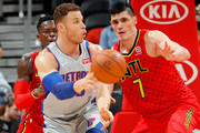 Blake Griffin #23 of the Detroit Pistons passes the ball against Dennis Schroder #17 and Ersan Ilyasova #7 of the Atlanta Hawks at Philips Arena on February 11, 2018 in Atlanta, Georgia.  NOTE TO USER: User expressly acknowledges and agrees that, by downloading and or using this photograph, User is consenting to the terms and conditions of the Getty Images License Agreement.