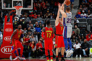 Blake Griffin #23 of the Detroit Pistons shoots a three-point basket over Ersan Ilyasova #7 of the Atlanta Hawks in the final seconds of their 118-115 loss at Philips Arena on February 11, 2018 in Atlanta, Georgia.  NOTE TO USER: User expressly acknowledges and agrees that, by downloading and or using this photograph, User is consenting to the terms and conditions of the Getty Images License Agreement.