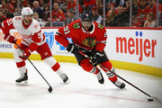 Anthony Duclair #91 of the Chicago Blackhawks looks to pass next to Frans Nielsen #51 of the Detroit Red Wings at the United Center on January 14, 2018 in Chicago, Illinois.