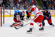 Ian Cole #23 of the Columbus Blue Jackets attempts to block the shot from Martin Frk #42 of the Detroit Red Wings as Sergei Bobrovsky #72 of the Columbus Blue Jackets makes the save during the first period on March 9, 2018 at Nationwide Arena in Columbus, Ohio.