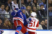 Pavel Buchnevich #89 of the New York Rangers throw a hit on Frans Nielsen #51 of the Detroit Red Wings during the first period at Madison Square Garden on November 24, 2017 in New York City.