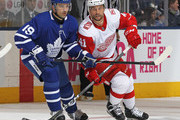 Luke Glendening #41 of the Detroit Red Wings skates against Tomas Plekanec #19 of the Toronto Maple Leafs during an NHL game at the Air Canada Centre on March 24, 2018 in Toronto, Ontario, Canada. The Maple Leafs defeated the Red Wings 4-3.