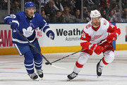 Luke Glendening #41 of the Detroit Red Wings skates against Tomas Pleakanec #19 of the Toronto Maple Leafs during an NHL game at the Air Canada Centre on March 24, 2018 in Toronto, Ontario, Canada. The Maple Leafs defeated the Red Wings 4-3.