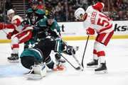 Hampus Lindholm #47, Brandon Montour #26 and John Gibson #36 of the Anaheim Ducks defend against a shot on goal by Frans Nielsen #51 of the Detroit Red Wings during the first period of a game at Honda Center on October 8, 2018 in Anaheim, California.
