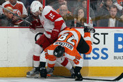Pierre-Edouard Bellemare #78 of the Philadelphia Flyers is hit by Riley Sheahan #15 of the Detroit Red Wings during the first period at the Wells Fargo Center on March 15, 2016 in Philadelphia, Pennsylvania.
