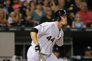 Justin Morneau #44 of the Chicago White Sox follows the flight of his three run home run in the 5th inning against the Detroit Tigers at U.S. Cellular Field on July 22, 2016 in Chicago, Illinois.