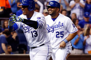 Salvador Perez #13 of the Kansas City Royals celebrates with Eric Hosmer #35 and Kendrys Morales #25 after hitting a 3-run home run during the 5th inning of the game against the Detroit Tigers at Kauffman Stadium on April 19, 2016 in Kansas City, Missouri.