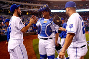 Salvador Perez #13 of the Kansas City Royals celebrates with Eric Hosmer #35 and Kendrys Morales #25 after the Royals defeated the Detroit Tigers 8-6 to win the game at Kauffman Stadium on April 19, 2016 in Kansas City, Missouri.