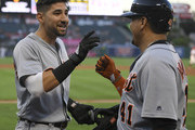 Nicholas Castellanos #9 of the Detroit Tigers is congratulated on his first inning home run by Victor Martinez #41 against the Los Angeles Angels of Anaheim at Angel Stadium on August 6, 2018 in Anaheim, California.