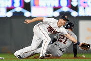 JaCoby Jones #21 of the Detroit Tigers steals second base as the ball gets past Logan Forsythe #24 of the Minnesota Twins during the second inning of the game on September 25, 2018 at Target Field in Minneapolis, Minnesota. Jones went to third base on the play.
