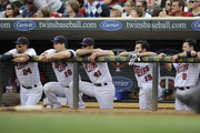 (L-R) Trevor Plouffe #24, Josh Willingham #16, Drew Butera #41, Darin Mastroianni #19 and Jamey Carroll #8 of the Minnesota Twins looks on during the ninth inning of the game against the Detroit Tigers on September 30, 2012 at Target Field in Minneapolis, Minnesota. The Tigers defeated the Twins 2-1.