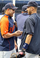 Derek Jeter #2 of the New York Yankees talks with former teammate Johnny Damon #18 of the Detroit Tigers prior to their game on August 16, 2010 at Yankee Stadium in the Bronx borough of New York City.