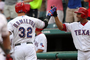 Josh Hamilton #32 of the Texas Rangers is congratulated by teammate Elvis Andrus #1 after hitting a solo homerun against Max Scherzer of the Detroit Tigers on August 10, 2012 at the Rangers Ballpark in Arlington in Arlington, Texas.