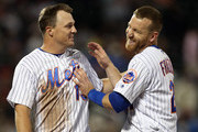 Jay Bruce #19 and Todd Frazier #21 of the New York Mets react between innings against the Philadelphia Phillies during a game at Citi Field on September 8, 2018 in the Flushing neighborhood of the Queens borough of New York City. The Mets defeated the Phillies 10-5.