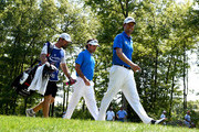 Bubba Watson and Webb Simpson walk down the 17th fairway during the final round of the Deutsche Bank Championship at TPC Boston on September 7, 2015 in Norton, Massachusetts.