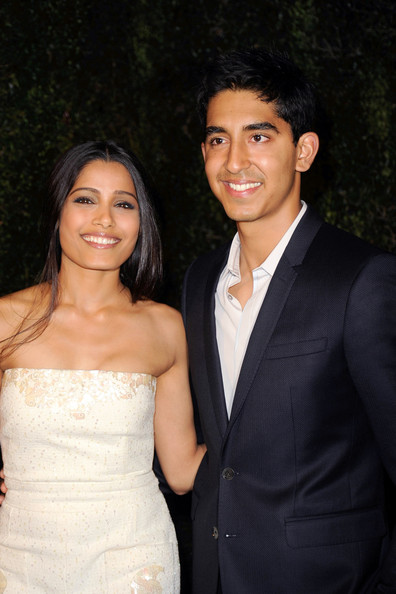 Dev Patel Actors Freida Pinto and Dev Patel arrive at the Chanel And Charles Finch Pre-Oscar Dinner at Madeo Restaurant on February 25, 2012 in Los Angeles, California.