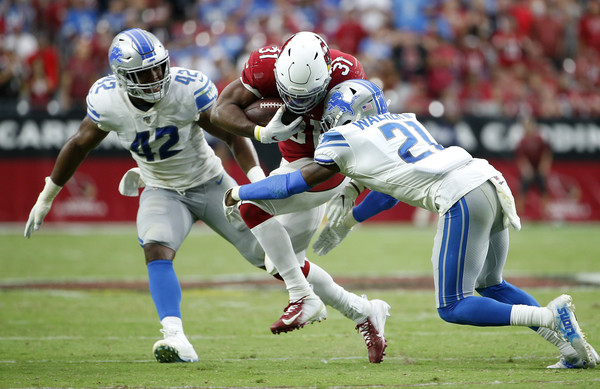 Detroit Lions v Arizona Cardinals [player,sports,sports gear,tournament,sports equipment,helmet,team sport,gridiron football,sprint football,ball game,david johnson,devon kennard,tracy walker,play,detroit lions,arizona cardinals,nfl,game,football game,half]