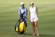 Lexi Thompson talks to her caddie on the fourth hole during the third round of the Diamond Resorts Tournament of Champions at Tranquilo Golf Course at Four Seasons Golf and Sports Club Orlando on January 18, 2020 in Lake Buena Vista, Florida.