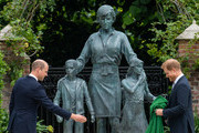 Prince William, Duke of Cambridge and Prince Harry, Duke of Sussex during the unveiling of a statue they commissioned of their mother Diana, Princess of Wales, in the Sunken Garden at Kensington Palace, on what would have been her 60th birthday on July 1, 2021 in London, England. Today would have been the 60th birthday of Princess Diana, who died in 1997. At a ceremony here today, her sons Prince William and Prince Harry, the Duke of Cambridge and the Duke of Sussex respectively, will unveil a statue in her memory.
