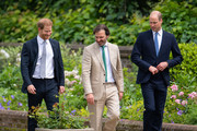 Prince Harry, Duke of Sussex and Prince William, Duke of Cambridge with garden designer Pip Morrison, arrive for the unveiling of a statue they commissioned of their mother Diana, Princess of Wales, in the Sunken Garden at Kensington Palace, on what would have been her 60th birthday on July 1, 2021 in London, England. Today would have been the 60th birthday of Princess Diana, who died in 1997. At a ceremony here today, her sons Prince William and Prince Harry, the Duke of Cambridge and the Duke of Sussex respectively, will unveil a statue in her memory.