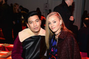 (L-R) Brianboy and Elizabeth Gilpin attends the Diane Von Furstenberg fashion show during Mercedes-Benz Fashion Week Fall 2015 at Spring Studios on February 15, 2015 in New York City.