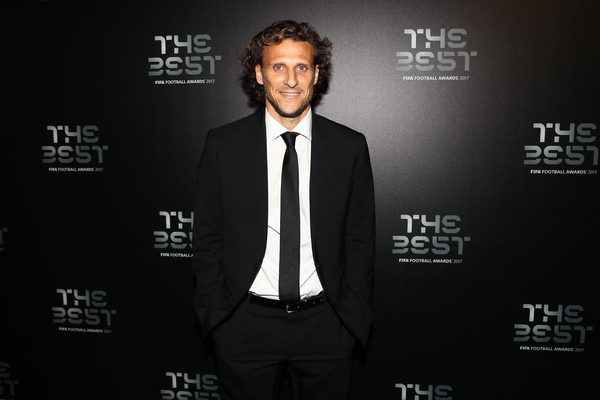 The Best FIFA Football Awards - Green Carpet Arrivals [suit,font,tuxedo,premiere,formal wear,white-collar worker,brand,green carpet arrivals,diego forlan,best fifa football awards,london,england]