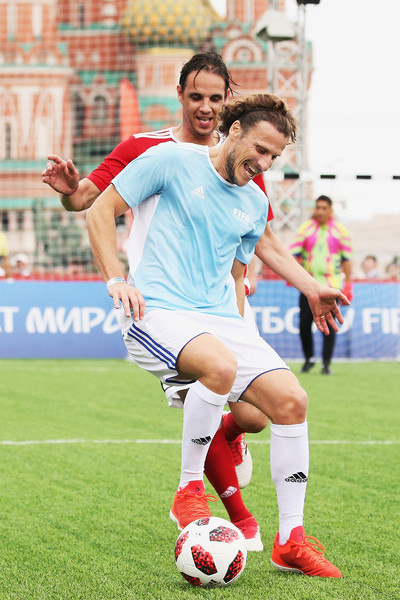 Legends Football Match - 2018 FIFA World Cup Russia [soccer player,soccer,ball game,football player,football,team sport,sport venue,sports,player,ball,nuno gomes,diego forlan,soccer,rest,russia,park,red square,moscow,l,legends football match - 2018 fifa world cup]