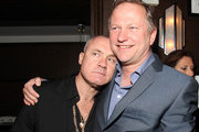 Artist Damien Hirst and Nick Jones at the Tracey Emin dinner hosted by Phillips and Vanity Fair at Cecconi's at Soho Beach House on December 3, 2013 in Miami Beach, Florida.