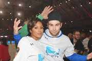 Alicia Quarles and Chace Crawford participate in the DirecTV Beach Bowl at Pier 40 on February 1, 2014 in New York City.