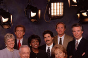 """20/20 CELEBRATES 17 YEARS - 6/2/95.Co-anchors Hugh Downs and Barbara Walters (front row) and the six  correspondents of ABC News """"20/20"""" (Lynn Scherr, Arnold Diaz, Deborah Roberts, John Stossel, Tom Jarred and Bob Brown) in a new photograph, celebrate the news magazine's 17th anniversary on June 6, 1995. The show, which debuted (on a Tuesday) June 6, 1978, now has six  correspondents - in addition to the anchors - for the first time since its first season. """"20/20"""", which has dominated its Friday night slot, finished the 1994-95 season #17 out of 146 shows, and  season-to-date, is the highest-rated news magazine among adults 18-49 and adults 25-54. Pictured, left to right: Lynn Scherk, Arnold Diaz, Hugh Downs, Deborah Roberts, John Stossel, Barbara Walters, Bob Brown."""