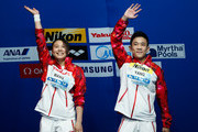 Gold medallists Han Wang and Hao Yang of China celebrate during the medal ceremony for the 3m Springboard Synchronised Mixed Diving Final on day nine of the 16th FINA World Championships at the Aquatics Palace on August 2, 2015 in Kazan, Russia.