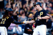 Justin Morneau #66 and Andrew McCutchen #22 of the Pittsburgh Pirates celebrate two runs scored in the first inning against the St. Louis Cardinals during Game Three of the National League Division Series at PNC Park on October 6, 2013 in Pittsburgh, Pennsylvania.