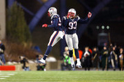 Chandler Jones #95 and Jabaal Sheard #93 of the New England Patriots celebrate after a play in the second half against the Kansas City Chiefs during the AFC Divisional Playoff Game at Gillette Stadium on January 16, 2016 in Foxboro, Massachusetts.