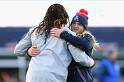 Jabaal Sheard #93 of the New England Patriots hugs Stephen Belichick, son of head coach Bill Belichick, during warms up for the the AFC Divisional Playoff Game against the Kansas City Chiefs at Gillette Stadium on January 16, 2016 in Foxboro, Massachusetts.
