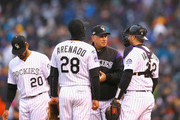 Manager Bud Black of the Colorado Rockies talks to catcher Chris Iannetta #22 and Nolan Arenado #28 after relieving Wade Davis #71 (not pictured) during the ninth inning of Game Three of the National League Division Series against the Milwaukee Brewers at Coors Field on October 7, 2018 in Denver, Colorado.