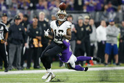 Ted Ginn #19 of the New Orleans Saints makes a catch defended by Mackensie Alexander #20 of the Minnesota Vikings during the first half of the NFC Divisional Playoff game at U.S. Bank Stadium on January 14, 2018 in Minneapolis, Minnesota.